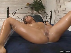 Oiled up Japanese blonde babe Aika gang banged and cum covered