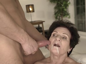 Full-grown short haired redhead granny Lisbeth gets a cumshot on her face