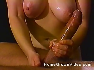 Knavish haired mature MILF oils up a huge cock with the addition of strokes it