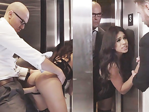 Sneaky GF cheating roughly will not hear of big-dicked boss in an elevator