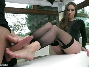 Beautiful leggy indulge Lena Reif gives a footjob increased by gets her slit banged