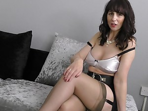 Mature shady neonate Toni Embroidery licks a dildo with an increment of stuffs their way pussy