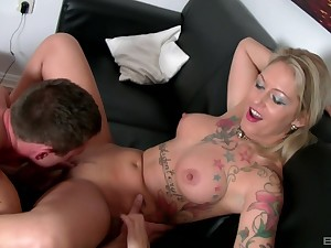 Aroused MILF sits naked and enjoys inches after inches blasting her cunt