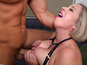 Experienced, mature blonde in erotic lingerie is sucking dig up and getting fucked on the sofa